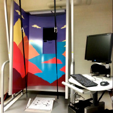 3-panel booth with colorful landscape and foot pedals on the floor
